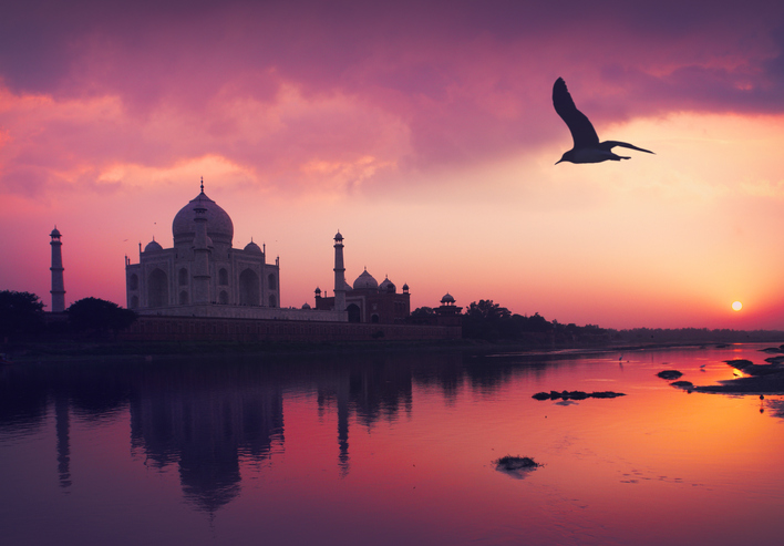 Taj Mahal and the Yamuna River by sunset in Agra, Uttar Pradesh, India